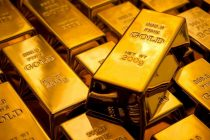 Gold Hovers Near 2 Week Lows as Dollar Gains on Upbeat US data