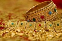 Gold Slips on Muted Spot Demand, Weak Global Trend