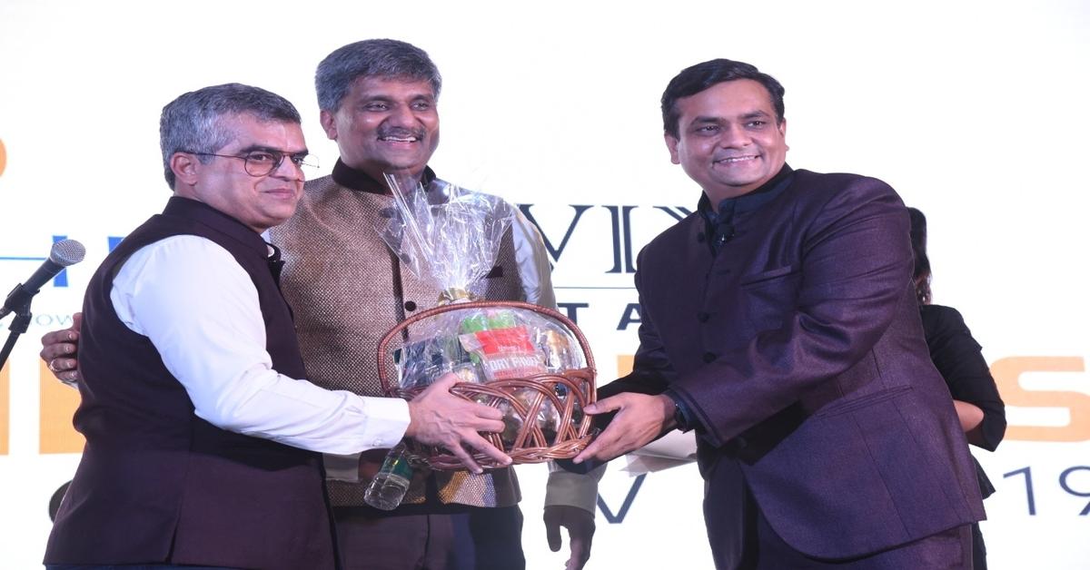 Mr Jignesh Mehta (right) & Mr Shailen Mehta (centre) felicitating Atul Khatri