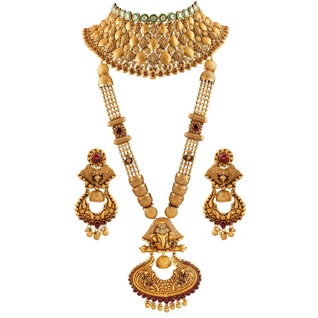 Bridal necklace set by ANMOL crafted in 22 K gold embellished with kundan and semi-precious stones.
