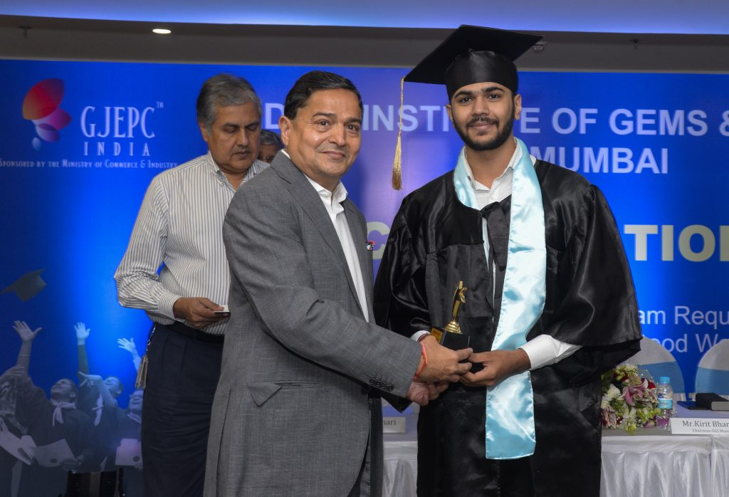 Mr. Kirit Bhansali, Chairman IIGJ Mumai presenting award to second runner up Mr. Shlok Jain for the academic excellence