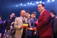 Atul Saraf, Director, Aisshpra Gems & Jewels receives Purvanchal Icon Awards from Actor Govinda