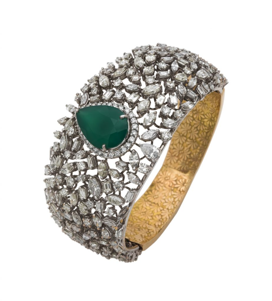 Cuff crafted in 18K gold with fine cut diamonds and emeralds