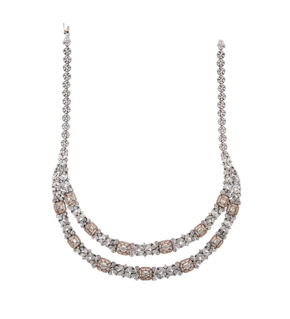 Neckpiece crafted in 18K gold studded with fine cut diamonds