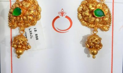 Manufacturers display diverse display of gold temple earrings at IIJS